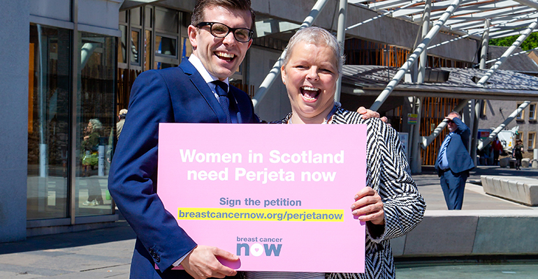 Jen Hardy and Laurence holding a Perjeta Now sign