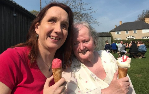 Sarah and her mum eating ice creams together in the sunshine
