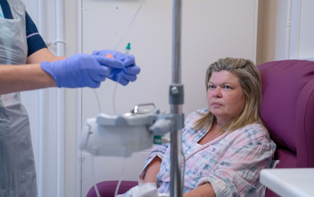 a woman receives chemotherapy treatment in hospital