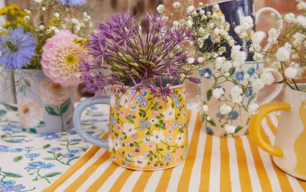 Floral patterned Cath Kidston mugs filled with flowers