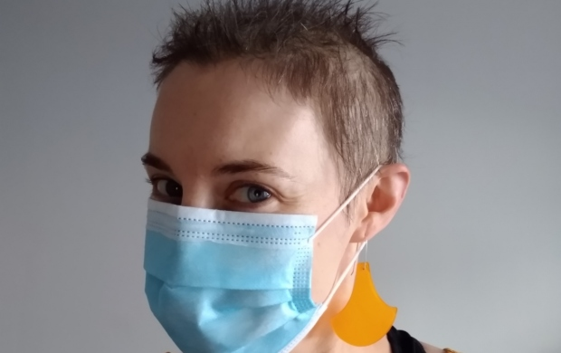 Chloe wearing a protective face mask and with her head shaved after chemo