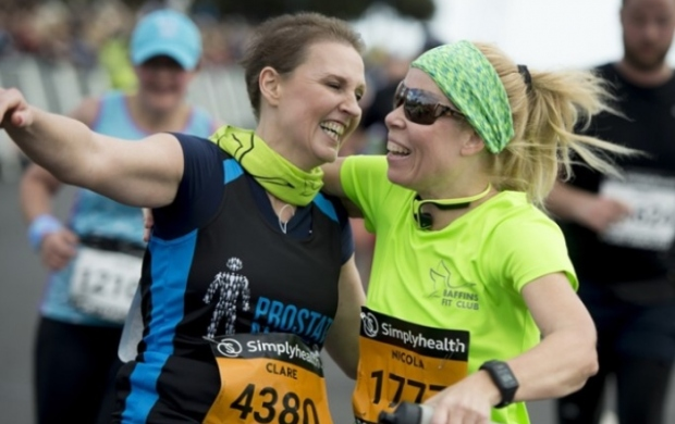 Clare and her running partner, Nikki, celebrating after finishing the Great South Run