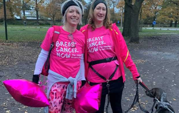 Dawn and her friend wear their pink Breast Cancer Now shirts and wait for their fundraisers in the park