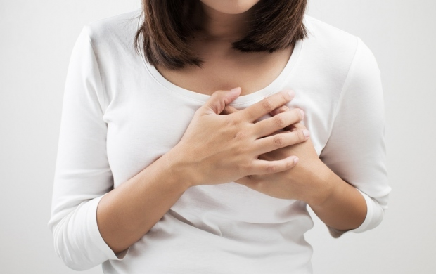 woman with breast pain