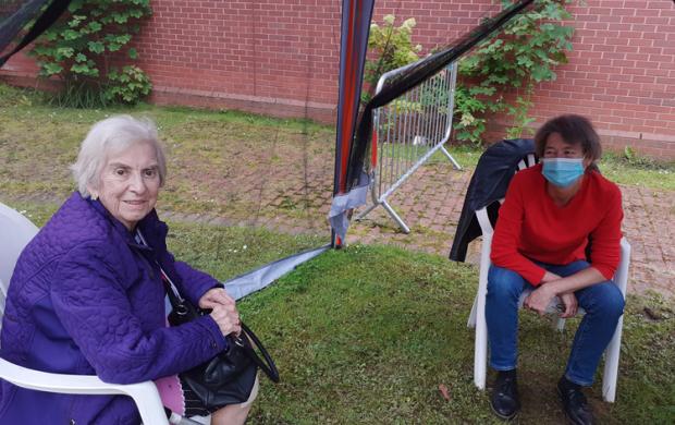 Maureen sitting with her mum