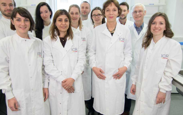 Clare Isacke standing in her lab with her research team