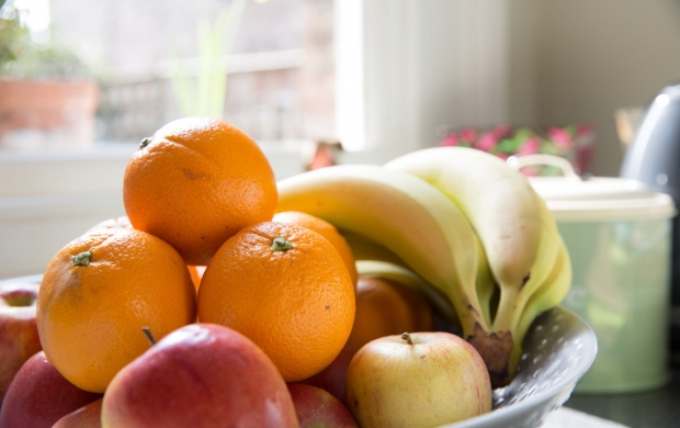 bowl of fruit on a windowsill