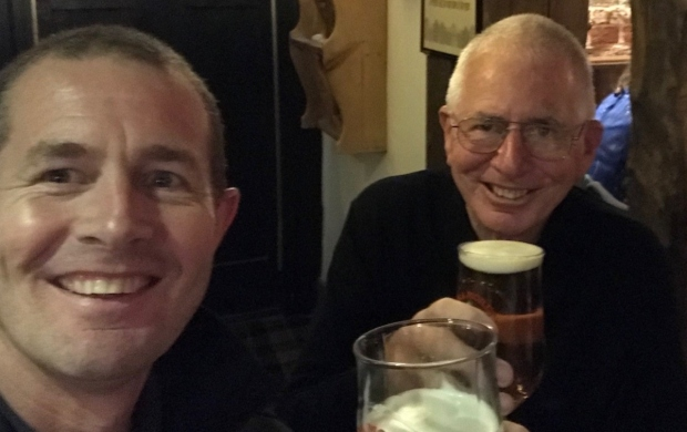 Graeme and his father, John, sit together in the pub