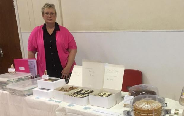 Jackie selling her cakes