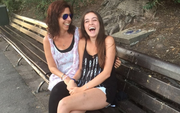Jess is laughing with her mother as they sit on a bench outside
