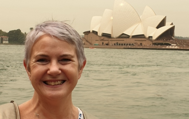 Joanne smiling in front of the Sydney Opera House