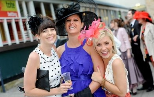 Women dressed up for Ladies Day