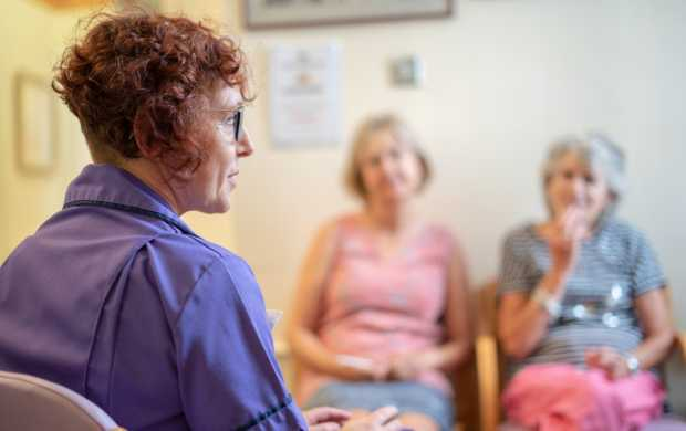 A female health care provider speaks with two older women