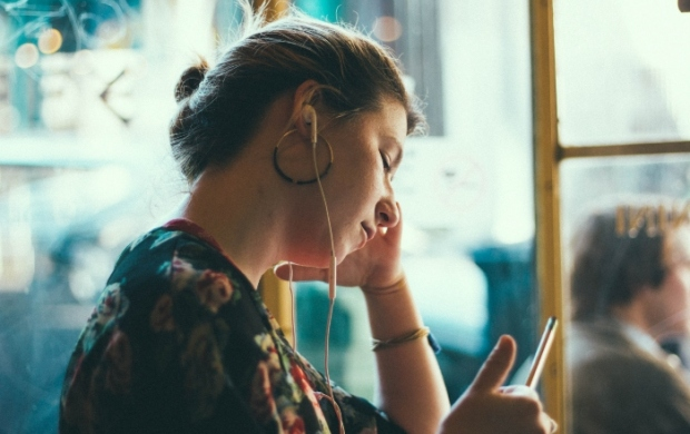 Woman listening to something with earphones
