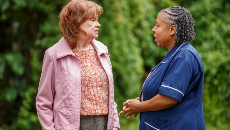 A nurse talking to a patient