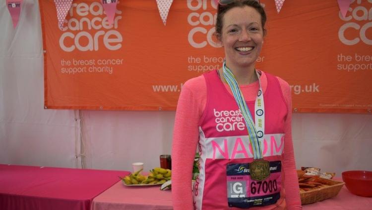 woman smiling after finishing marathon