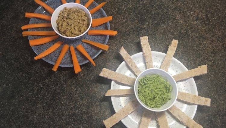 two dips fanned by breadsticks and carrots