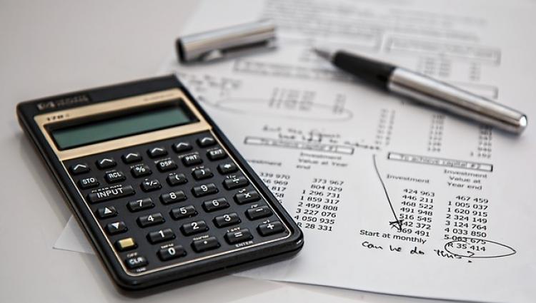 A calculator, pen and paper