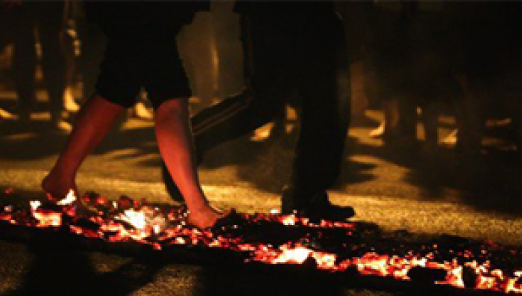 People completing firewalk