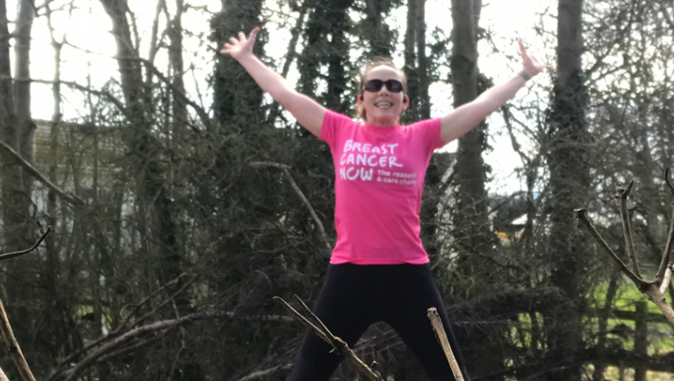A Breast Cancer Now runner jumping