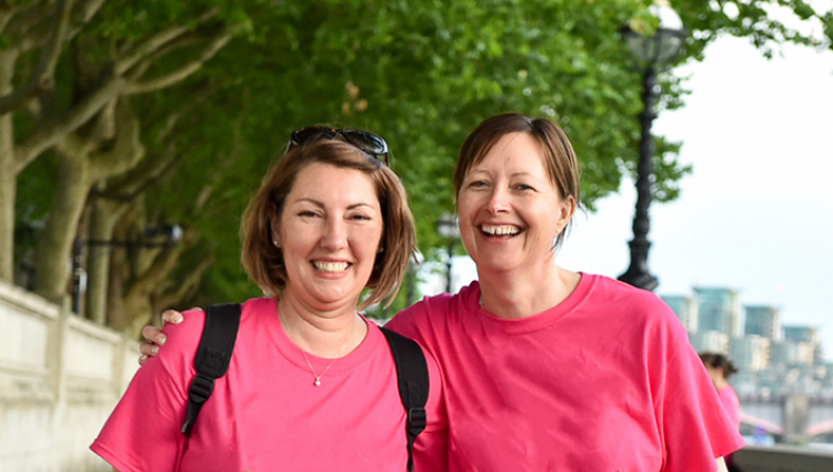 Two women in pink t-shirts