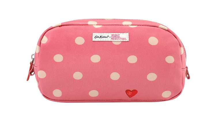 Pink makeup case with pale yellow spots