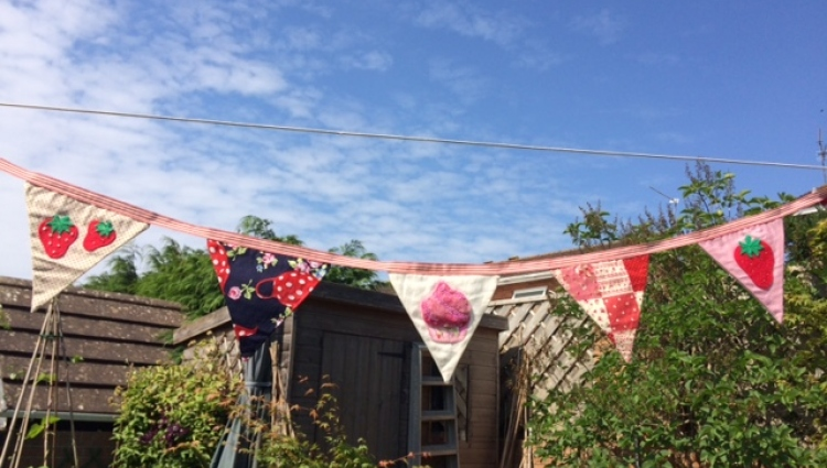Colourful bunting in a garden