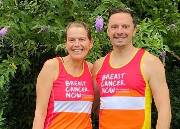 Danielle and her husband, Mark, wearing their Breast Cancer Now running vests