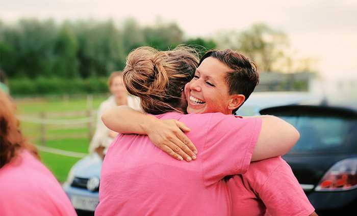Two women, hugging