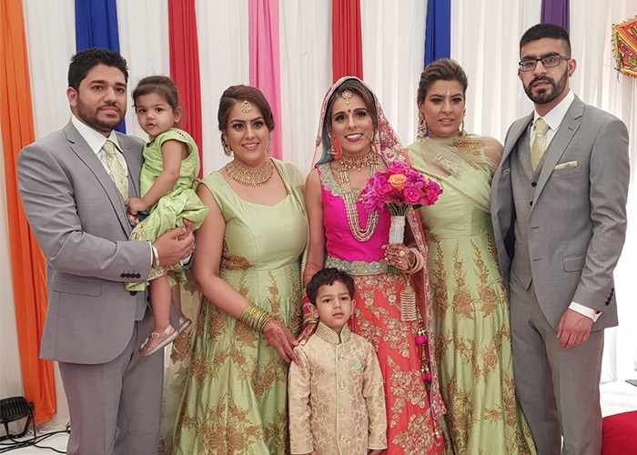 Kiren and her family at a wedding