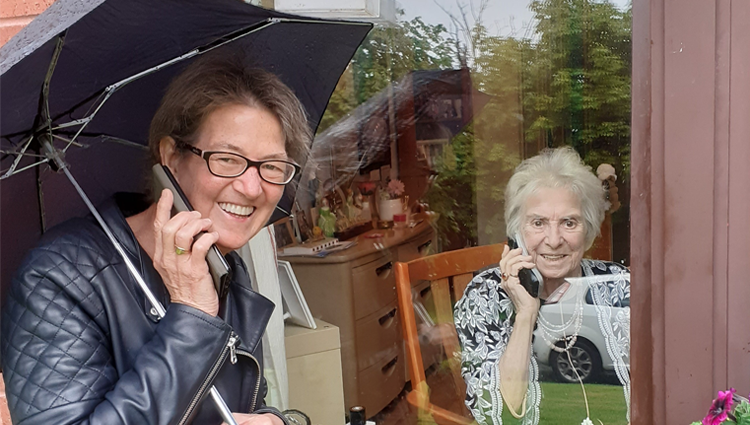 Maureen on the phone with her mum