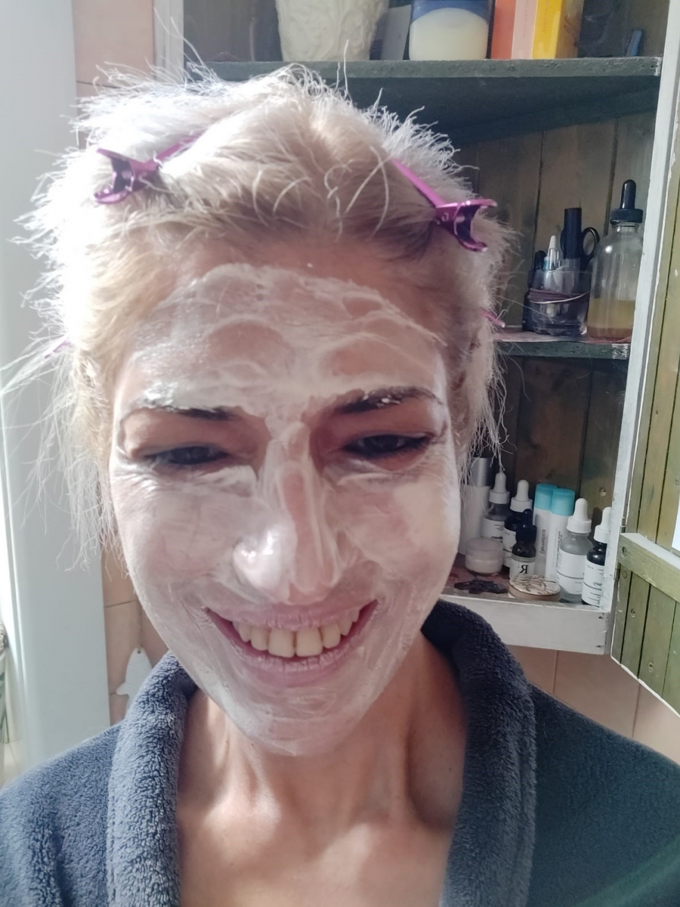Sherin smiling with moisturiser all over her face