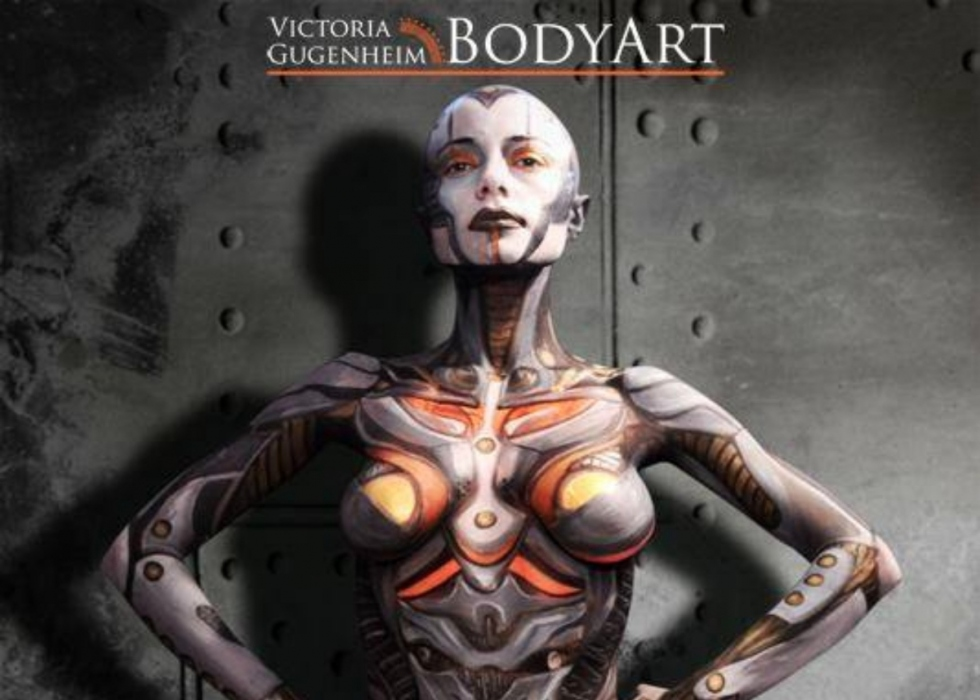 A model painted by Victoria to appear mechanical. They have a shaved head, and have silver detailing all over them.