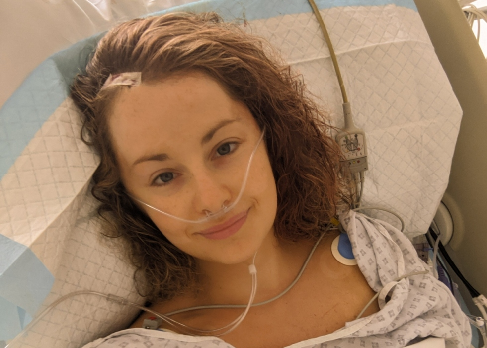 Fran, a young woman, in a hospital bed after surgery