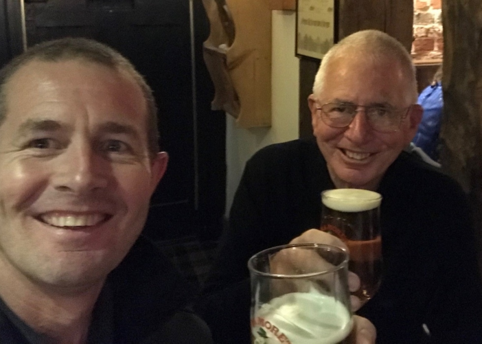 Graeme and his father, John, sit together in the pub enjoying a pint of beer