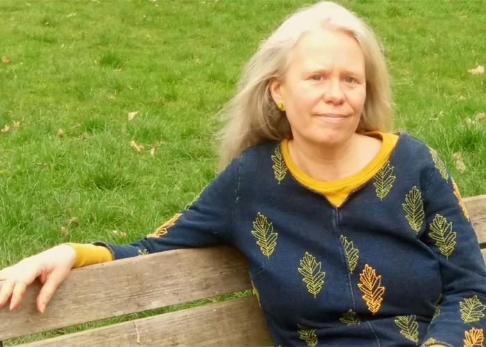 Karin sitting on a bench