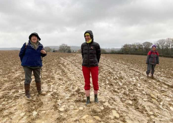 Jane and two friends from the Kent International Club going on a socially distanced muddy walk