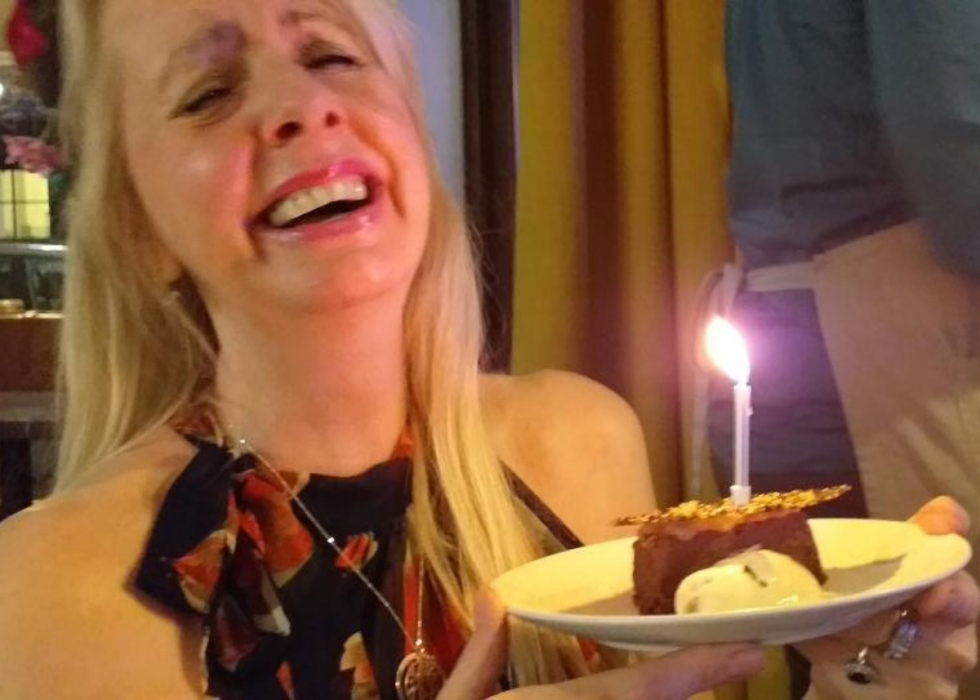 Natasha smiling in a restaurant on her birthday