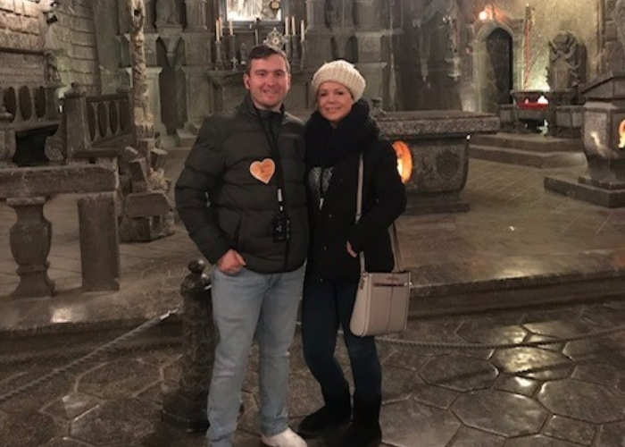 Rachel and her partner standing together inside an old church
