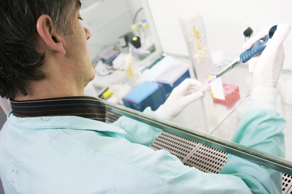 A male researcher using a pipette