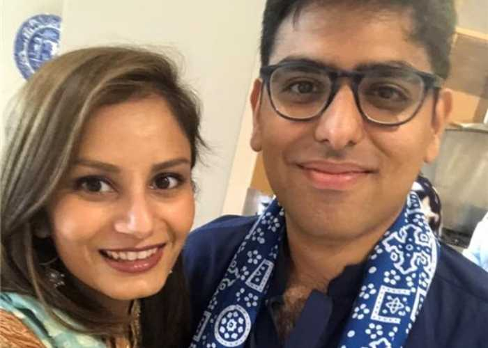 Sania and Asad, a young couple, smile for the camera