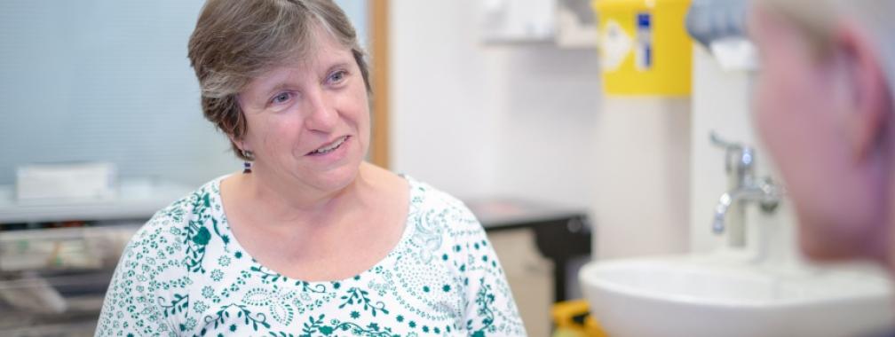 a woman talking to a nurse