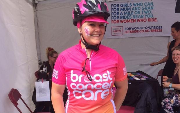 Carol cycling at the Pink Ribbon Tour
