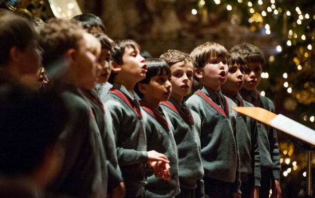 Boys choir singing in a carol service