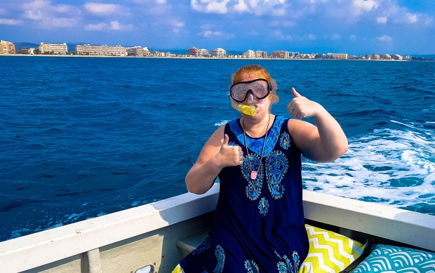 Jenni on a boat with mask and snorkel