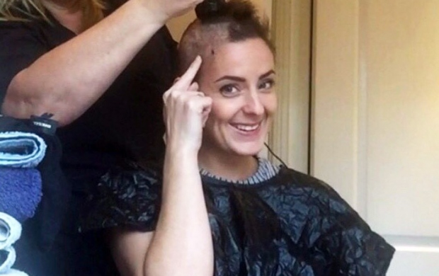 Lucy having her head shaved