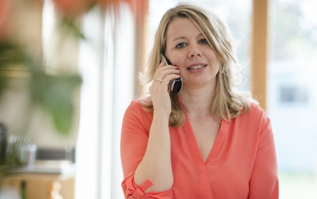 Woman with breast cancer rings our Helpline for support and information