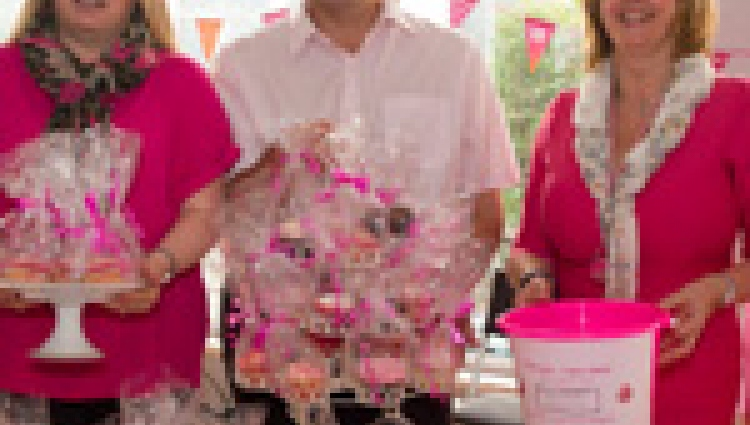 A group of people having a Big Pink bake sale