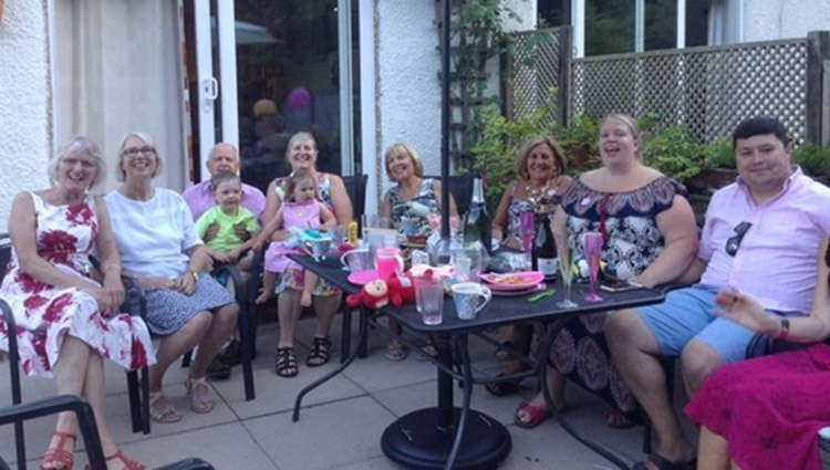 Frances and her family having tea outside