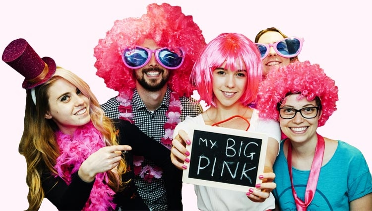 A group of people in pink holding a sign saying 'My Big Pink'